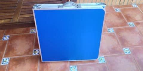 mesa maleta plegable guardada desmontada